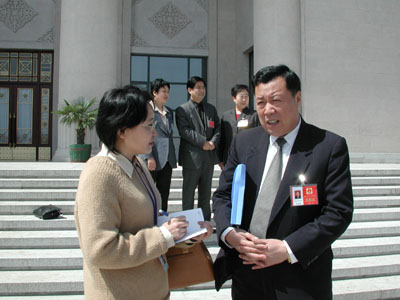 李德崇/河北区代表李德崇说,上午听了市长的报告很受鼓舞,报告完全...